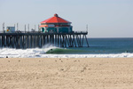 Surfing The Pier In Huntington Beach CA